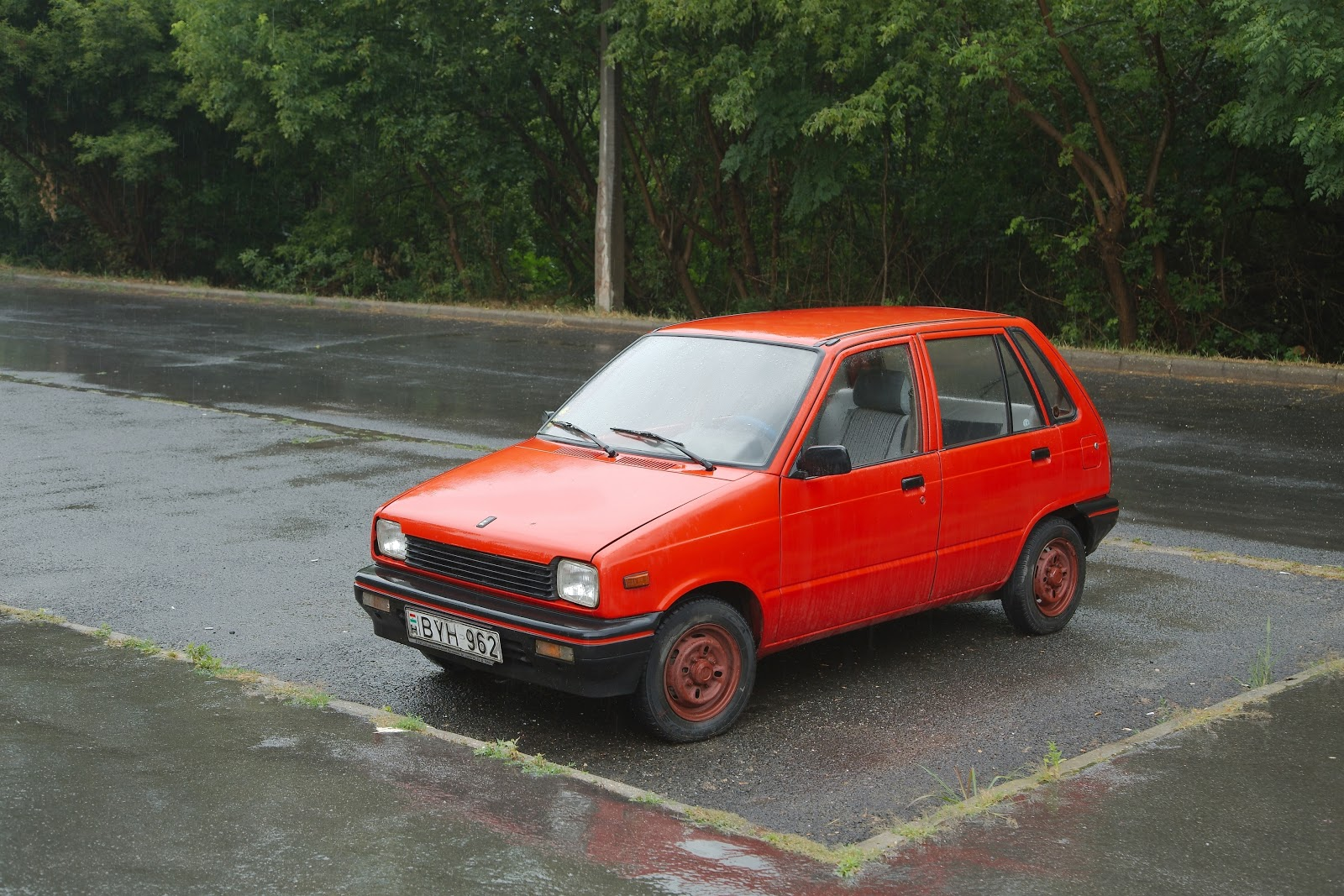 budapest-hungary-may-old-maruti-parked-in-the-street-in-rainy-weather-popular