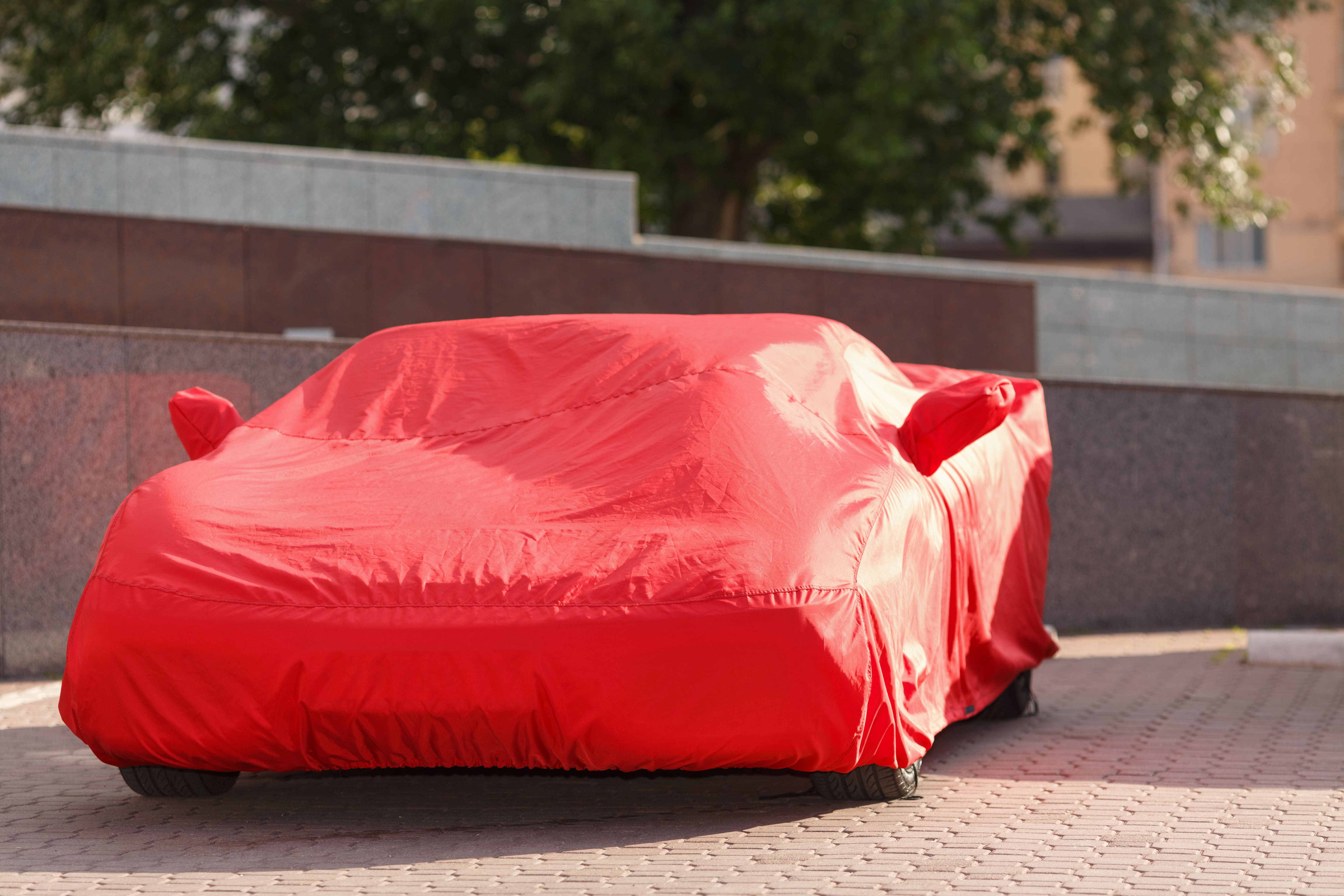 luxurious-red-roadster-cover-protects-against
