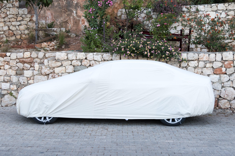 passenger-car-covered-white-sheet-on