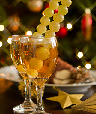 Happy New Year - champagne, grapes and party decoration