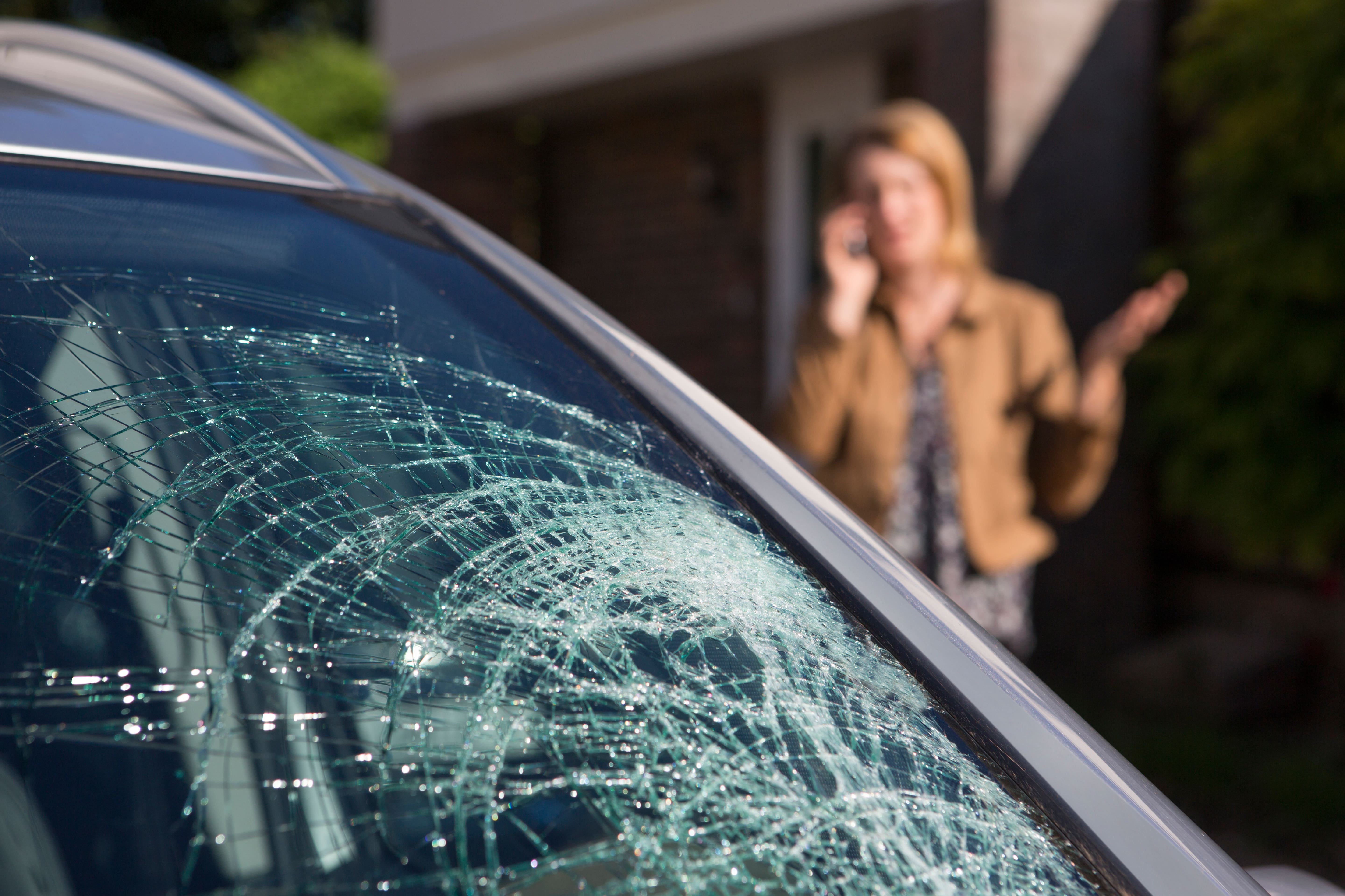 woman-phoning-help-after-car-windshield